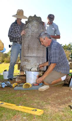 volunteers restoring a headstone