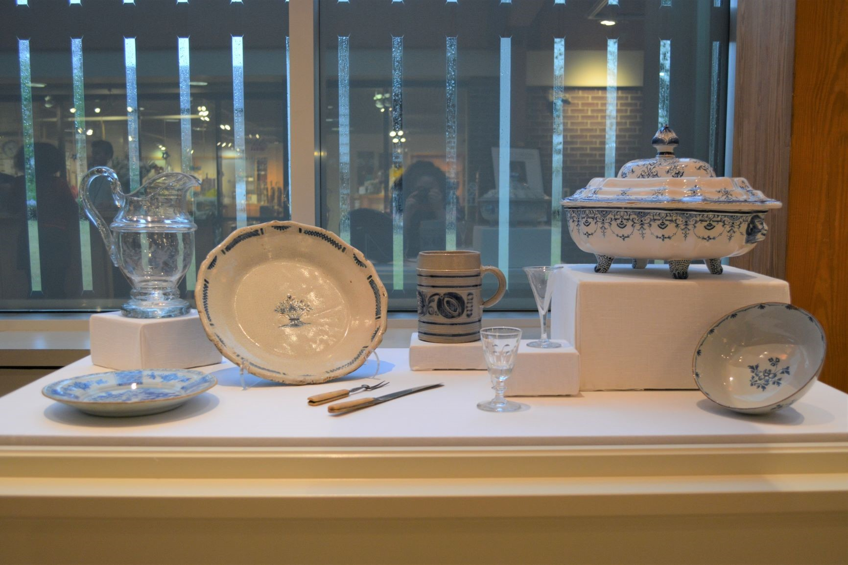 display of white dishes with blue decorative patterns