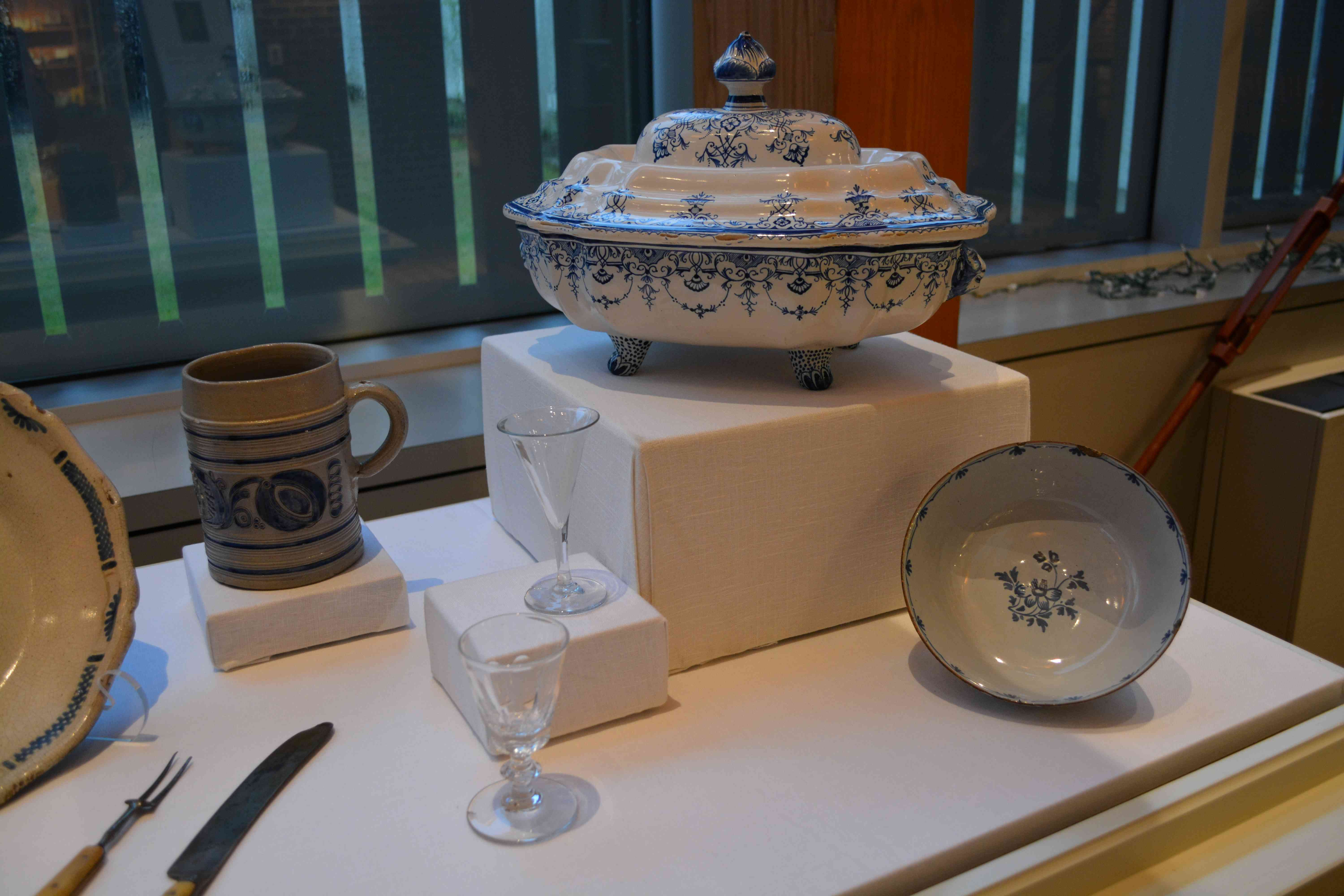 white bowl and serving dish, glass drinking glasses, beer stein