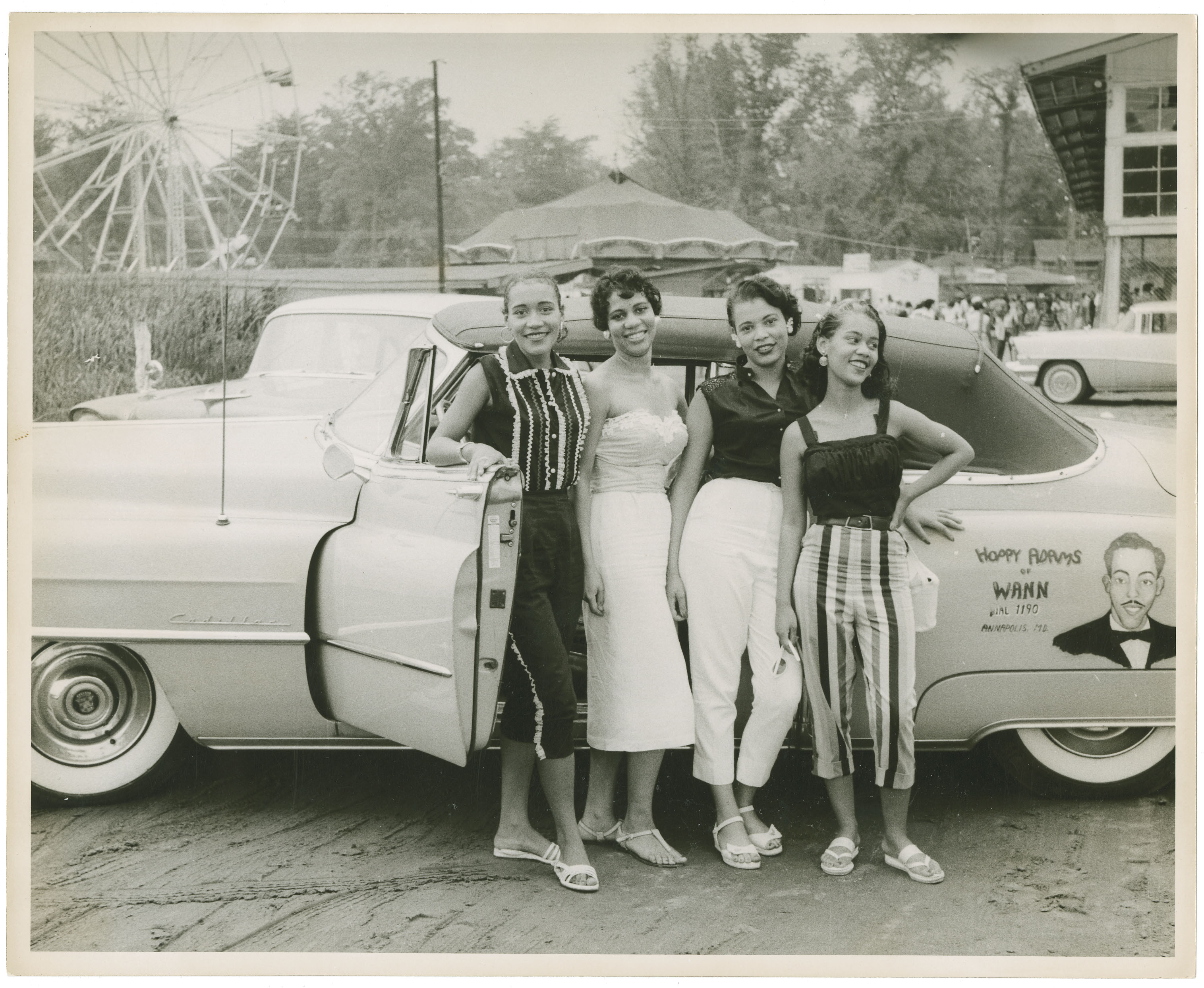 Four girls in front of car