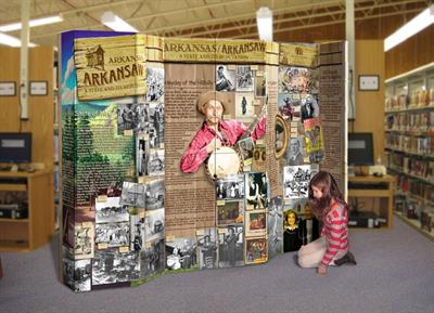 young girl kneeling on ground by Arkansas exhibit display