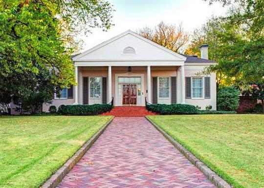 colonial house with brick pathway and columns